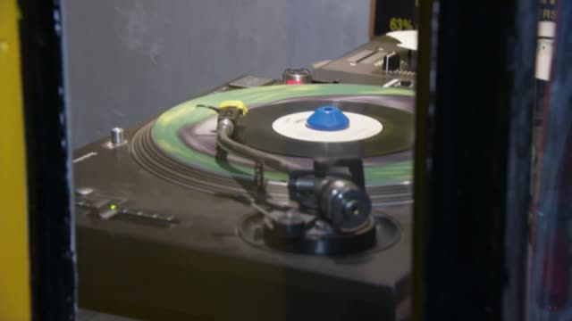 cultural significance of reggae music honoured by unesco; england: london: brixton: ext / night gv lion vibes record shop int various of lion vibes... - レゲエ点の映像素材/bロール
