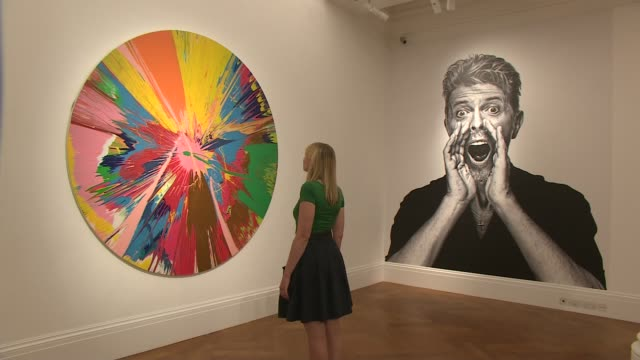 david bowie art collection goes on show before auction london sotheby's overlay david bowie 'lazarus' *** various of paintings and sculptures from... - サザビーズ点の映像素材/bロール