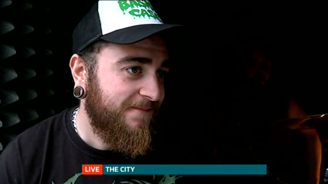 'Death Metal' band play in soundproof box in The City ENGLAND London The City EXT Reporter to camera Interview with death metal band 'Unfathomable...