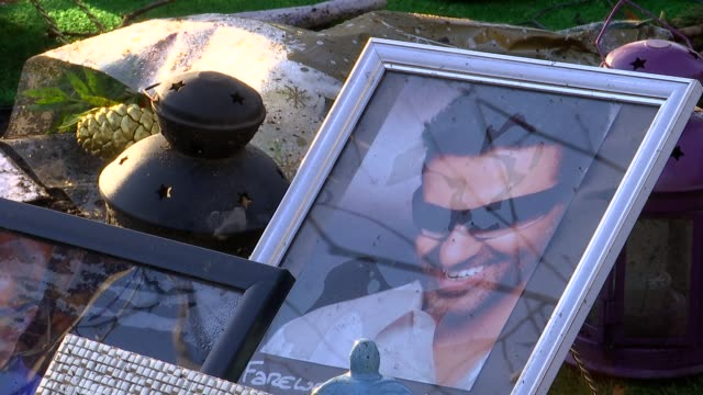 george michael shrine; england: london: highgate: ext gvs george michael tributes left in park - shrine stock videos & royalty-free footage