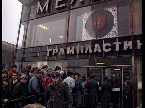 Greenpeace record on sale in Moscow b RUSSIA Moscow EXT Music fans PULL OUT PAN LR entrance to record store as fans queue outside and policemen wait...
