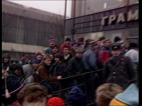 greenpeace record on sale in moscow russia moscow ext music fans pull out pan lr entrance to record store as fans queue outside and policemen wait... - david 'the edge' howell evans stock videos and b-roll footage