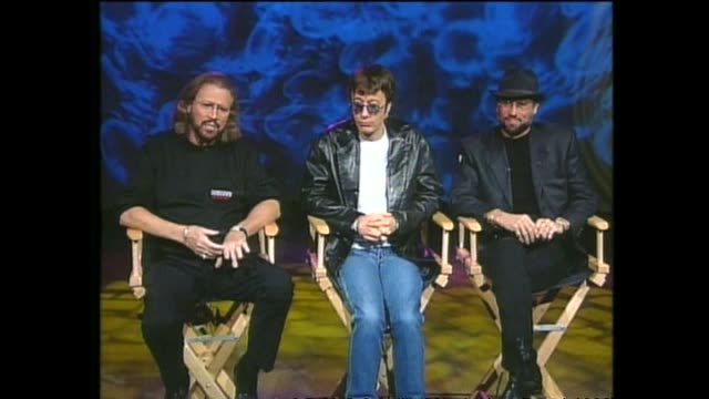 pop music group bee gees interviewed via satellite from miami by host paul holmes about managing their financial success. - the bee gees bildbanksvideor och videomaterial från bakom kulisserna