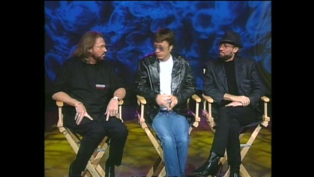 pop music group bee gees interviewed via satellite from miami by host paul holmes about their families and children and their potential musical... - the bee gees bildbanksvideor och videomaterial från bakom kulisserna