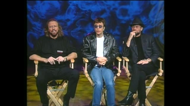 pop music group bee gees interviewed via satellite from miami by host paul holmes about their successful hit music career and what made their sound... - the bee gees bildbanksvideor och videomaterial från bakom kulisserna