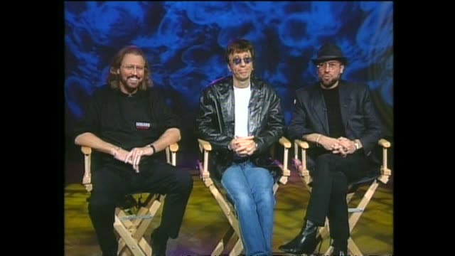 """pop music group bee gees interviewed via satellite from miami by host paul holmes about their forthcoming """"one night only"""" concert tour and writing... - the bee gees bildbanksvideor och videomaterial från bakom kulisserna"""