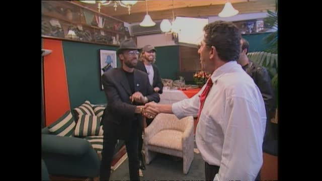 pop music group bee gees meeting with host paul holmes backstage at western springs stadium in auckland before their concert the following night. - the bee gees bildbanksvideor och videomaterial från bakom kulisserna