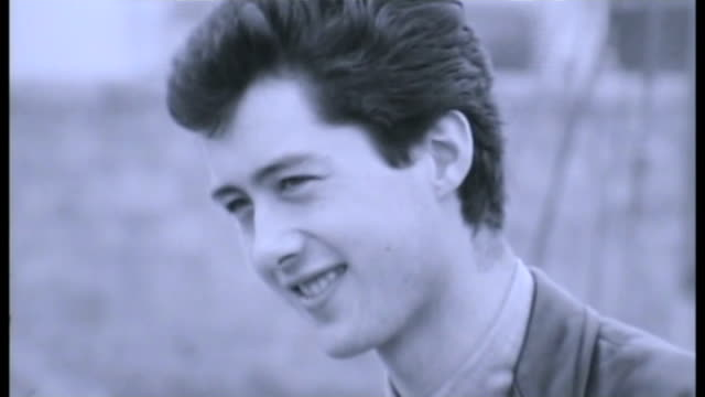 jimmy page interview; 1963 location unknown: ext b/w page interview sot - [on what it's like to work with some of the big names of showbusiness]... - b rolle stock-videos und b-roll-filmmaterial