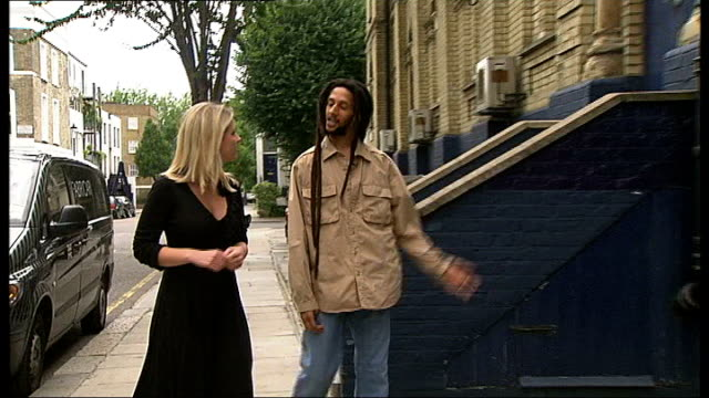 stockvideo's en b-roll-footage met julian marley in london; julian marley interview sot notting hill: ext julian marley along and into recording studio int clive black interview sot - bob marley musician