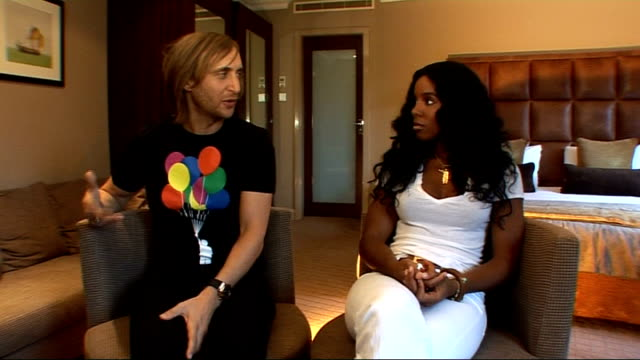 stockvideo's en b-roll-footage met kelly rowland and david guetta interview; england: london: int kelly rowland and david guetta interview sot - discuss their working collaboration and... - kelly rowland