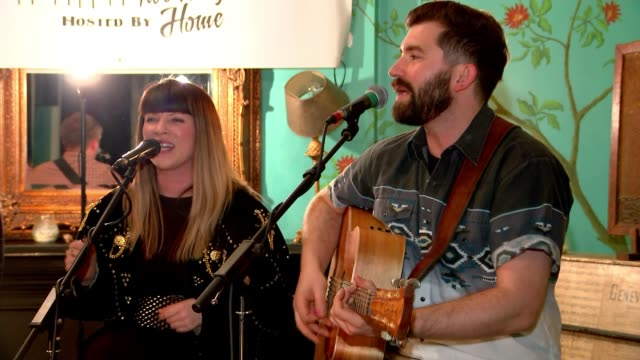 Launch of UK's first country music radio station ENGLAND INT Various of duo performing song on stage at country music showcase event in pub SOT...