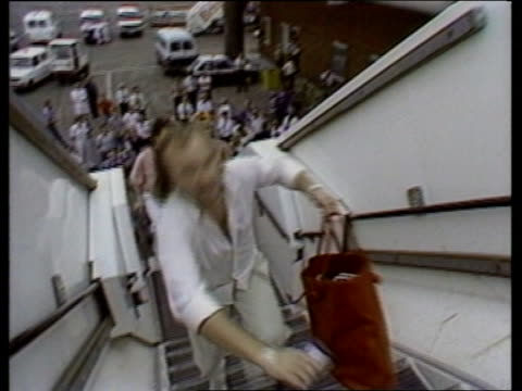 live aid concerts donations continue to pour in england lap ms helicopter taxiing on tarmac tms collins up plane steps towards intvw it's good fun do... - phil collins stock videos & royalty-free footage