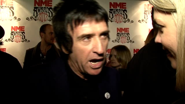 nme awards 2012 arrivals and interviews johnny marr red carpet interview sot awards have got a lot bigger/ not as illicit as it used to be death of... - ジョニー マー点の映像素材/bロール