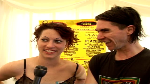 reading festival: backstage scenes and interviews; int amanda palmer and brian viglione interview sot - on their set, weather, wellies, playing... - pros and cons stock videos & royalty-free footage
