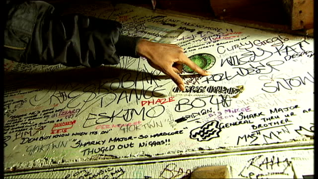 rise of grime music / 'culture clash' event at earls court jammer interview showing graffiti by other grime artists on walls of basement sot reporter... - cafe culture stock videos and b-roll footage