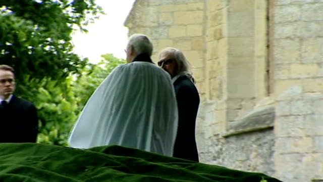 robin gibb funeral; barry gibb along with dwina gibb and other family members walk along behind hearse/ mourners walk along towards church/ tim rice,... - tim rice stock videos & royalty-free footage