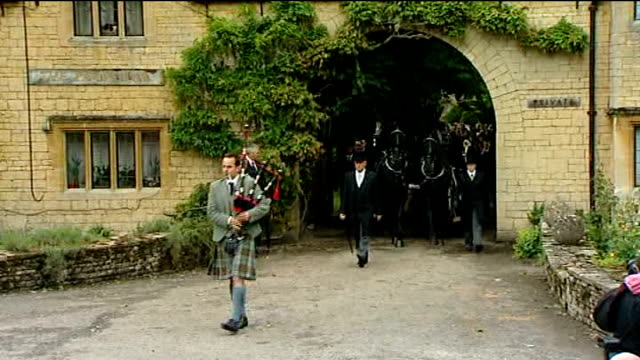 robin gibb funeral england oxfordshire thame ext horsedrawn hearse out through gates of large house led by bagpiper/ barry gibb along with dwina gibb... - tim rice stock videos and b-roll footage