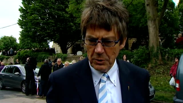 robin gibb funeral; various shots of mourners leaving church/ david 'kid' jenson , mike read and vanessa brady along from funeral mike read interview... - tim rice stock videos & royalty-free footage