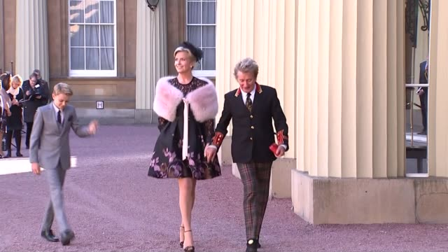 rod stewart knighted; buckingham palace: ext sir rod stewart and his wife penny lancaster along from palace - sir rod holding his knighthood medal box - rod stewart stock-videos und b-roll-filmmaterial