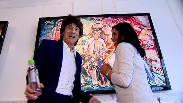 ronnie wood art exhibition and interview ronnie wood and reporter stand chatting in gallery in front of ronnie wood painting - music stand stock videos & royalty-free footage