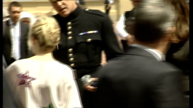 Minogue outside Palace after ceremony ENGLAND London Buckingham Palace EXT Singer and actress Kylie Minogue signing autographs whilst mingling with...