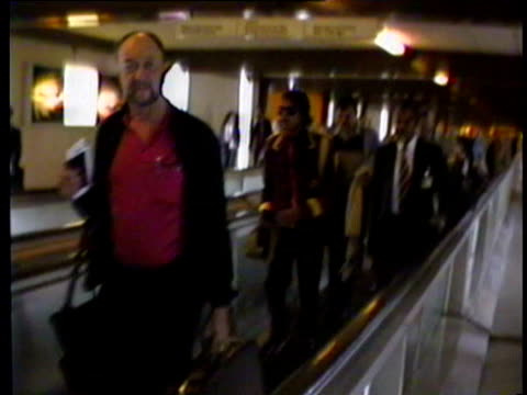 pop singer michael jackson walking along airport corridor with others; photographers and paparazzi crowding around michael jackson; michael jackson... - マイケル・ジャクソン点の映像素材/bロール
