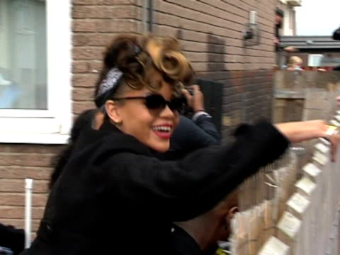 pop star rihanna creates bedlam as she meets fans and shows her stuff in the new lodge area of belfast as she films her latest music video rihanna... - northern ireland stock videos & royalty-free footage