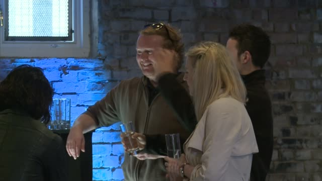 pop up bar in shoreditch only serves water ext vox pops customer sot people in bar drinking water sign 'h2only bar' cub llewelyndavies interview sot... - away we go video stock e b–roll