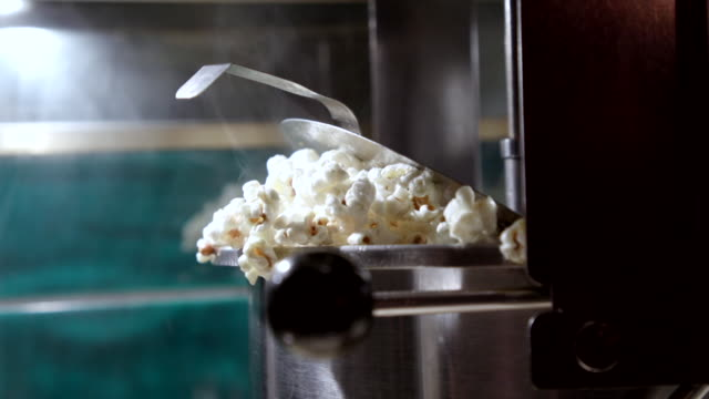 cu popcorn at cinema - arts culture and entertainment stock videos & royalty-free footage