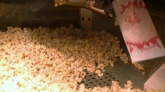 popcorn at the theater - biosalong bildbanksvideor och videomaterial från bakom kulisserna