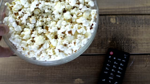 popcorn bowl placed next to remote control - remote control stock videos & royalty-free footage
