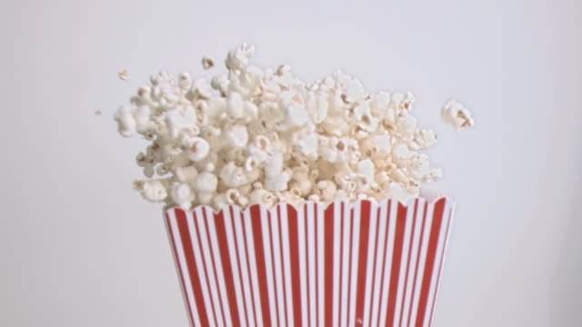 popcorn falling in super slow motion - popcorn stock videos & royalty-free footage