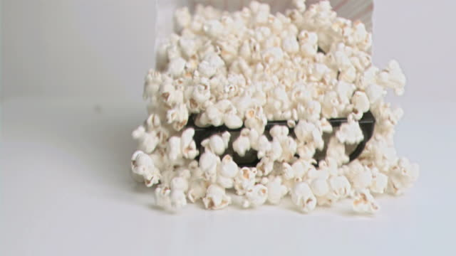 Popcorn falling in super slow motion with 3D glasses