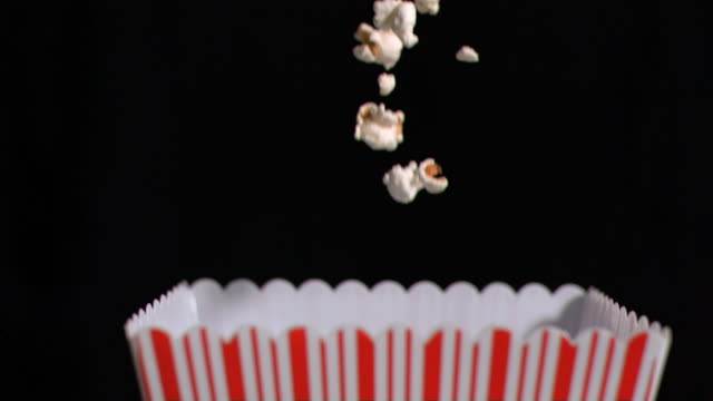 Popcorn falling into box in super slow motion
