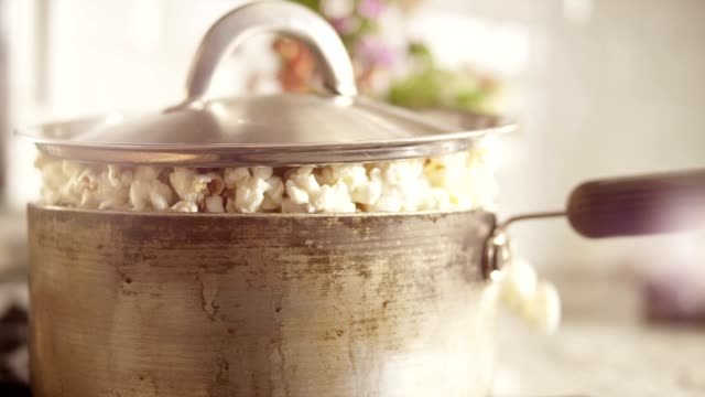 popcorn overflow from pot - popcorn stock-videos und b-roll-filmmaterial