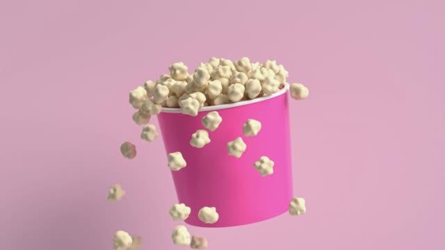 popcorn pink bucket cartoon style 3d render motion - design element stock videos & royalty-free footage