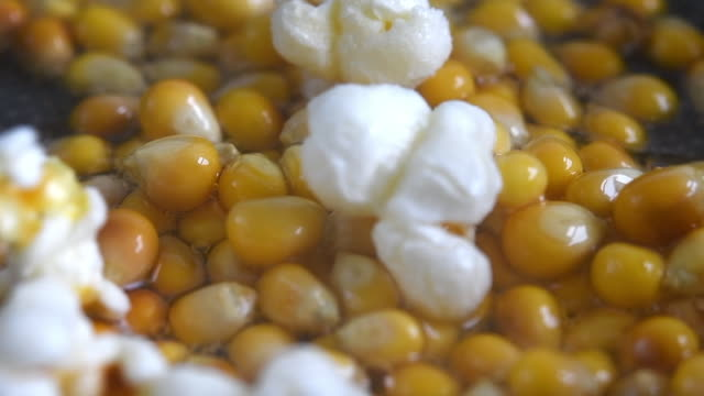 Popcorn popping in the frying pan, close-up