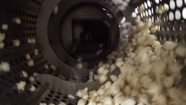 popcorn spinning around barrel in factory - craft stock videos & royalty-free footage