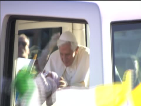 pope benedict xvi kisses baby during papal visit to bellahouston park - 法王ベネディクト16世点の映像素材/bロール