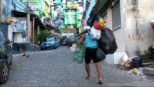 hopes for election of pope from latin american man along carrying bags paulo otaviano interview sot - 法王ベネディクト16世点の映像素材/bロール
