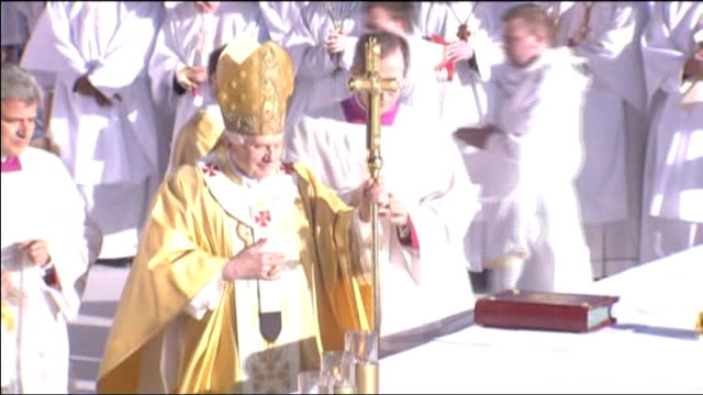 pope benedict xvi state visit: day one; **choir music heard sot** pope along during open-air mass and kissing altar ends - pope stock videos & royalty-free footage