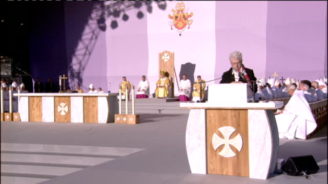day one mass at bellahouston park first reading from the letter of st paul to the romans sot congregation and pope listening - romans stock videos and b-roll footage