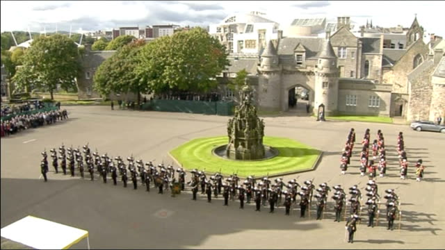 Day one Palace of Holyroodhouse High angle view of soldiers Side view of Queen Elizabeth II standing Pope out of car and along to shake hands with...