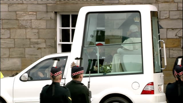 day one Pope and Queen speak at Holyrood Palace / Procession through Edinburgh High view of Popemobile outside Holyrood House as group of soldiers...