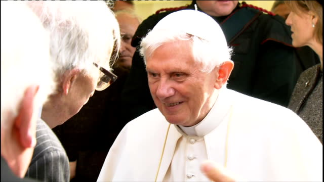 day one Pope and Queen speak at Holyrood Palace / Procession through Edinburgh INT More of Pope meeting people / Pope speaking with elderly man /...