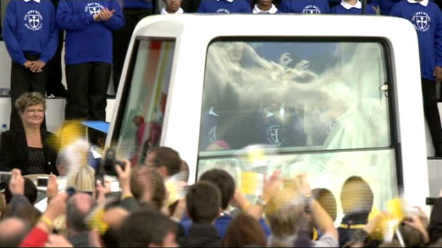 pope benedict xvi state visit: day two; pope benedict xvi along in popemobile past screaming crowd popemobile and stage seen from above - ローマ法王専用車点の映像素材/bロール