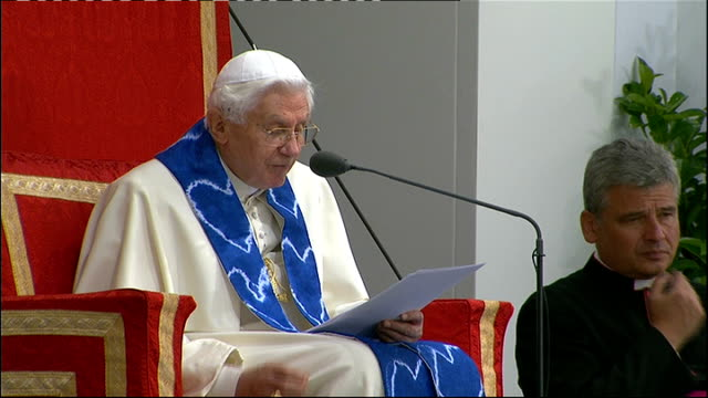day two pope benedict xvi speaking sot they can lead us seriously astray back view of congregation listening pope benedict xvi as raises his hands to... - blessing stock videos & royalty-free footage