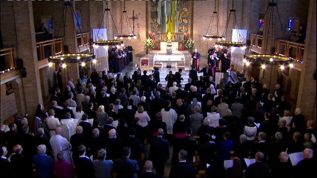 Day Two St Mary's University College INT **Music heard SOT** Pope and others arriving in chapel as congregation sing SOT / Pope kneeling down in...