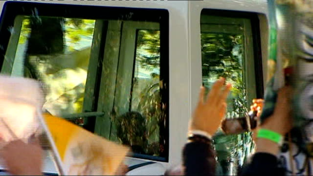 pope benedict xvi state visit: experiences of pilgrims; pope waving to crowd from popemobile - ローマ法王専用車点の映像素材/bロール