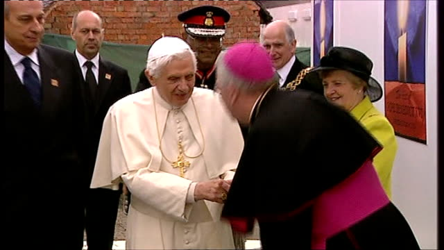 pope benedict xvi state visit: final day: cofton park arrival; long shot of pope benedict greeting officials / pope benedict greeting paul sabapathy... - ローマ法王専用車点の映像素材/bロール